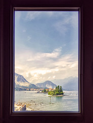 On Isla Bella, through a window at Palazzo Borromee, Lake Maggiore, Italian Lake District (Randy Durrum) Tags: lake water boat boats stresa sky clouds mountain durrum samsung s6 isla bella maggiore palazzo borromee