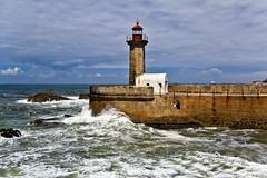 The lighthouse and the fisherman (ricardocarmonafdez) Tags: seascape lighthouse faro mar sea waves olas cielo sky nubes clouds sunlight canon 60d 1785isusm