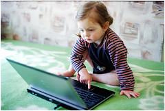 IT kid (batuda) Tags: portrait film 35mm analog analogue color colour om2n om 5014 c41 kid child girl miglė computer laptop šančiai kaunas 2016 april