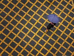 Walk through the Parking lot. (Emu Alim) Tags: human umbrella line yellow diagonal straight pola dots sony