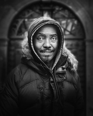 Jeffrey (mckenziemedia) Tags: man homeless homelessness chicago city urban street streetphotography portrait portraiture blackandwhite monochrome face coat hoodie hood people humanity human smile