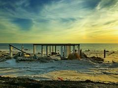 Another Michael Series: Beach houses at sunset (+4) (peggyhr) Tags: peggyhr remnants destruction devastation sunset shadows ocean sunlight whitesand stilts pillars clouds sky img0542b mexicobeach florida thegalaxy frameit~level01~ thegalaxylevel2 thegalaxystars thegalaxyhalloffame frameit~level02~