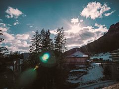 UFO (Мaistora) Tags: mountain alps dolomites tyrol peak hills trees pine forest village alpinesky clouds sunshine light shadows houses blue green yellow snow winter edit process postprocess lightroom leica dlux typ109 landscape scape color colour lens flare defect effect ufo splash spot