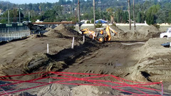 (Rich T. Par) Tags: pomona phillipsranch socal southerncalifornia losangelescounty lacounty constructionsite california palmtrees tree road suburb dirt civilengineering tubes tractor heavyequipment pipes backhoe backhoeloader loaderbackhoe digger drill drillingmachine drillingtruck