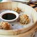 Lucky 12 - Stack of 3 Sui Mai with black vinegar chicha de jora dipping sauce (Chifa). TRADICIONAL-Pork, shrimp, jicama, shitake mushroom, peanut