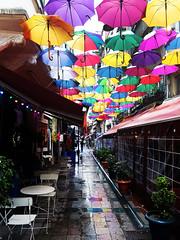 Umbrellas  Taksim (Colin McLurg) Tags: taksim instanbul istikalalstreet colinmclurg 2019 turkey rain rainyday umbrellas cantine colourscolors reflection streetscene bar