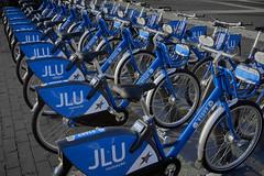 Blue bikes (Ulrich Neitzel) Tags: bicycle bike blau blue fahrrad giessen jlu mzuiko1250mm many olympusem5 rental repetition sharing wiederholung