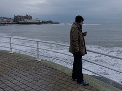 grey day Aberystwyth 6 (watcher330) Tags: aberystwyth man sea coastline