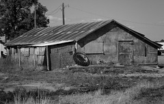 Retired (arbyreed) Tags: arbyreed monochrome blackandwhite bw shed building metalbuilding abandoned tire corrugatedmetalbuilding weldcountycolorado greeley old forgotten