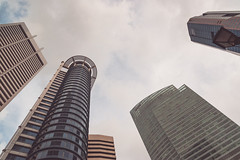 Looking Up In Singapore (Shane Hebzynski) Tags: buildings urban skyscrapers clouds sky singapore outdoors happyplanet