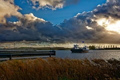 Just Before The Warming Filtre (Alfred Grupstra) Tags: nauticalvessel transportation harbor sea cloudsky water nature freighttransportation ship sky sunset industrialship cloudscape shipping cargocontainer modeoftransport outdoors commercialdock pier travel ferry