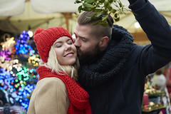 Christmas Kissing: How Mistletoe Became a Kissing Cue (alsfakia) Tags: psychology by alexandros g sfakianakis anapafseos 5 agios nikolaos 72100 crete greece 00302841026182 00306932607174 alsfakiagmailcom christmasmarket fair streetmarket mistletoe kissing couple christmas holiday eyesclosed winter cold christmasornaments marketstall togetherness above holding smiling toothysmile happiness people heterosexualcouple fete symbol celebration traditionalfestival man woman december street cultures tradition outdoors temperature citylife concepts season daylight coat copyspace leisureactivity cheerful choice twopeople