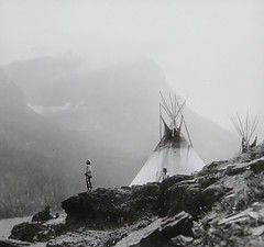 """""""Echoes Call"""" by Roland W. Reed (1913). Lantern Slide Image 40 (L70513), Keystone View Company (lhboudreau) Tags: nativeamericans nativeamerican americanindian vintagephoto vintagephotograph vintagephotography rolandreed monochrome blackandwhite blackwhite rolandwreed pictorialist focus lighting fog foggy misty echoescall echoscall 1913 mountainside lanternslide image keystone keystoneview keystoneviewcompany image40 slide40 l70513 reedindianunits meadvillepa outdoor outdoors reed indian photo antiquephoto tipi teepee water mountain rock rocks people indians americanindians mist dwelling shore landscape slide"""