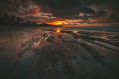 Clouds on fire (MIW1971) Tags: hawaii sunrise beach clouds sky water ocean rocks longexposure kauai island orange yellow love color surf palm tree