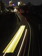 Outbound. (Freddy Berlin) Tags: berlin night urban outdoor available light architecture germany city metropolis capital dark cloudy lights train sbahn subway rail distance public speed time shutter long exposure olympus omd em10 em10iii iii mft micro four thirds 45mm 18 panasonic jpeg sooc m43