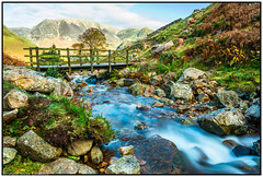 Bridge over Scale Beck near Crummock Water, Cumbria. (steve.gombocz) Tags: sceneryshooting simplylandscapes landscape cumbria westcumbria colour colours color colourmania natureisbeautiful lakedistrict lakedistrictuk out outandabout outdoors landscapephoto landscapephotograph landscapephotography water river beck scenery bridge footbridge landscapescenes mountain hill crag fell landscapepicture nicepicture flickrlandscapes flickrscenery explorelandscapes explorescenery nikon nikond810 nikonusers nikonfx nikoncamera nikkor nikon140240mmf28 green blue grass fern stone