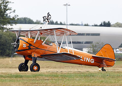 Boeing Stearman (Graham Paul Spicer) Tags: breitling wingwalkers girls ladies aerobatics wingwalking aerosuperbatics boeing stearman trainer vintage classic preserved aircraft plane biplane fbo farnborough airshow display flying aviation