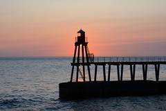 A whitby Sunrise. (Andy bradders) Tags: sea whitby waves water pier lighthouse yorkshire eastcoast andybradders andybradshaw andrewbradshaw nikon d7100 redsky morning sunrise sun harbour dracula clevelandway whiterose godscounty uk england holidays earlymorning boat horizon clouds northyorkshire