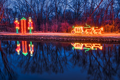 Christmas Greetings! (tquist24) Tags: christmas elkhart elkhartriver hdr indiana nikon nikond5300 bluehour decorations festive geotagged holiday lights longexposure reflection reflections river sky tree trees water