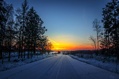 Sunset in the north (dannygreyton) Tags: sunset sweden countryside canon canong1xiii road winter snow cold ice colorful trees