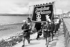 N87-16 Faslane March 1981 (hoffman) Tags: antinuclear banner cnd demo demonstration horizontal march peace protest walking water davidhoffman wwwhoffmanphotoscom glasgow scotland