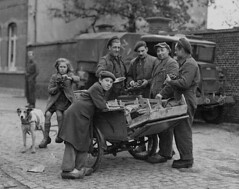 Corporal A. McLean and Sappers J.H.D. Pratte and P.E. Rivet, all of the Royal Canadian Engineers (R.C.E.), purchasing grapes from a Belgian with a dog-drawn cart, Bockhoute, Belgium / Trois membres du Génie royal canadien (le caporal A. McLean et les sape (BiblioArchives / LibraryArchives) Tags: lac bac libraryandarchivescanada bibliothèqueetarchivescanada canada workingdogs chiensdetravail dog dogs chien chiens cart charrette girl fille boy garçon soldier soldats royalcanadianengineers géniemilitairecanadien belgium belgique bockhoute lieutenantdonaldigrant october201944 20octobre1944 departmentofnationaldefence ministèredeladéfensenationale grapes raisins