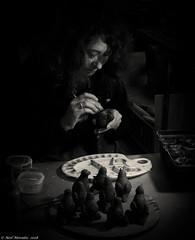 Clay and paint. (Neil. Moralee) Tags: neilmoralee clay paint woman girl lady painter painting pottery china coalport dark spot light work working potter low dim olympus omd em5 minatures birds face portrait ironbridge iron bridge demonstration neil moralee uk england britain history historic museum