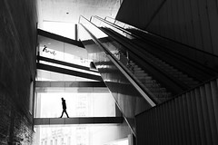 (cherco) Tags: man walk alone architecture arquitectura aloner andar lonely light luz lines blackandwhite blancoynegro composition composicion canon city ciudad canoneos5diii calle solitario solitary silhouette silueta shadow street sombra shadows stairs floor madrid market monochrome