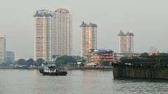 Sunrise On The Chay Phraya River (Anne Marie Clarke) Tags: river bangkok tugboat barge buildings water chayphraya sunrise goldenhour