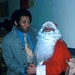 Man with Santa at Pike Place Market merchants' holiday party, 1975