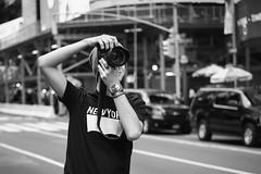 Street photographer, Times square (Michael Erhardsson) Tags: newyork manhattan midtown timessquare square public place people tourism landmark usa unitedstates blackandwhite monochrome photo photographer young man tourist camera dslr takingphotos