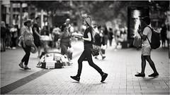 running the gauntlet (gro57074@bigpond.net.au) Tags: woman people candidphotography candidstreet candid busy cbd pittstreetmall sydney monotone monochrome mono blackwhite bw f14 105mmf14 artseries sigma d850 nikon