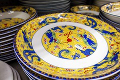 Chinese plates with dragon motif on display (Victor Wong (sfe-co2)) Tags: antique antiquities asia asian black ceramics ceremony china chinese clay culture decoration design detail dishes dragon elegance fragile glossy gold home japan japanese matte motif object orange ornament ornate pattern plate porcelain posh price red retro rich sale saucer service tag traditional warm white yellow
