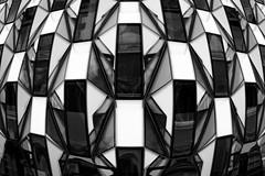 Bulging (Sean Batten) Tags: london england unitedkingdom gb oxfordst blackandwhite bw boots architecture abstract city urban nikon df 60mm glass window