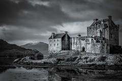 Eilean Donan Castle (Alan E Taylor) Tags: architecture atmospheric bw blackwhite blackandwhite building castle coast coastal countryside dark dramatic europe fineart fortification landscape lightroom loch mono monochrome noiretblanc ocean scotland scottish sea seleniumtone shore skylum skylumtonalityck tourism tourist travel uk unitedkingdom water britain british heritage historic historical history old highland gb