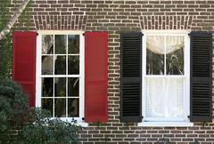 Close neighbors with little in common: Ansonborough, Charleston, SC (Spencer Means) Tags: dwwg ansonborough charleston architecture building tenement wall brick brickwork shutters red black neighbors sc southcarolina