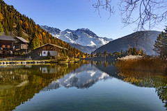 Champex and the Grand Combin at Autumn time 2018. Canton Of Valais. Switzerland. izakigur 14.11.18, 12:37:27 no. 568. (Izakigur) Tags: champex switzerland svizzera lasuisse lepetitprince thelittleprince ilpiccoloprincipe helvetia liberty izakigur flickr feel europe europa dieschweiz ch musictomyeyes nikkor nikon suiza suisse suisia schweiz suizo swiss سويسرا laventuresuisse myswitzerland landscape alps alpes alpen schwyz suïssa luz lumière light licht ضوء אור प्रकाश ライト lux światło свет ışık autumn automn trees tree garden fall herbst automne autunno outono 秋 पतझड़ خريف پاییز סתיו eau water romandie