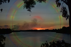 Delusion (Dreaming of the Sea) Tags: sunset manipulation smokeysunset water burnettriver bundaberg queensland australia redsunset reflections clouds gumtrees sky sun summer nikond7200 tamronsp2470mmf28divcusd gimp