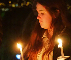 Candlelight Ceremony . (Irene, W. Van. BC) Tags: candlelightceremony candles lights lightreflections light candlelights litcandles ceremony ceremonies memorials memorialtree park parkscenes people allpeople celebrations beautifulceremony girl portraitofgirl portraits girlwithcandle 1001nights 1001nightsmagiccity seagardenpark