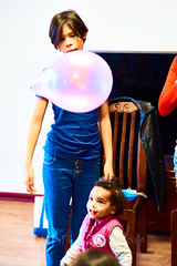 Noe and the Balloon 07 (ArdieBeaPhotography) Tags: girl preteen blue top black hair orange balloon jump leap catch hit purple jeans inside pop highcontrast slim pretty cute fringe arms lift raise bounce string rubber latex toy play fun sit stand tamronspaf2875mmf28xrdildasphericalif