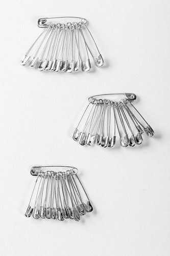 Safety pins, which pinned to the fabric