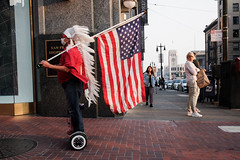 Untitled (kenwalton) Tags: americanflag armedforces attire boulevard clothes clothing costume feathers flag getup headgear highway hoverboard human humans mask masks masquerade military outfit pedestrian pedestrians people person photography photographyf road service sidewalk sidewalks starsstripes starsandstripes street streetphoto streetphotography streets usaflag urban vehicle vehicles walker walkers types streetphotographer