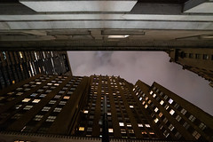 Squeezed between two giants of the old prosperity (wwward0) Tags: architecture building canyon cc city cloudy fidi financialdistrict manhattan night nyc outdoor overcast tower windows wwward0
