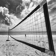 Caught (Robert Streithorst) Tags: beach clouds mono net robertstreithorst sand sky squares stthomas usvi vollyball