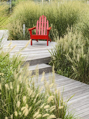 Long Island City, New York: The Red Chair (rocinante11) Tags: chair red grass newyork longislandcity adirondack