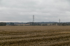 Farmland — Clinton Township, Knox County, Ohio (Pythaglio) Tags: farmland landscape pleasant scenic vista field farm agriculture rural cultivated stubble cables wires powerlines clouds overcast valley hills trees knoxcounty clintontownship