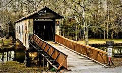 Covered bridge (Pedro1742) Tags: bridge wood history signs reflections trees