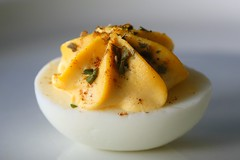 deviled egg (HansHolt) Tags: deviledegg egg half hardboiled yolk mustard mayo tabasco parsley spices yellow macro tabletop canoneos6d canonef100mmf28macrousm