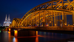 Cologne, Germany (TomST.Photography) Tags: cologne köln germany deutschland brücke bridge ponte germania colonia koeln night nacht longexposure dom dome chiesa duomo hohenzollernbrücke hohenzollernbridge hohenzollern eisenbahnbrücke train railbridge