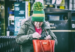 The pom pom. (Mister G.C.) Tags: street streetshot streetphotography photograph image candid people woman lady female smoker smoking cigarette woollyhat pompom unposed color colour coloured colored farbe urban town city sonya6000 sonyalpha mirrorless telephoto zoom lens sel18105 18105mm sonyglens sony18105mmepz f4 mistergc strassenfotografie glasgow scotland uk unitedkingdom gb greatbritain europe